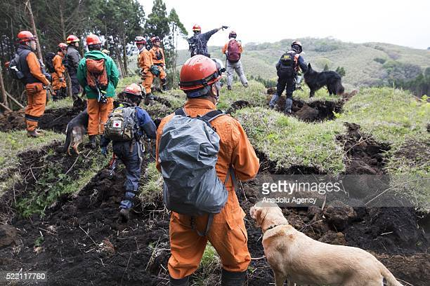 Rescue team with K9 dogs continue to find missing bodies on April 18 2016 in Minamiaso Kumamoto Japan The magnitude 73 earthquake hit Kyushu just...