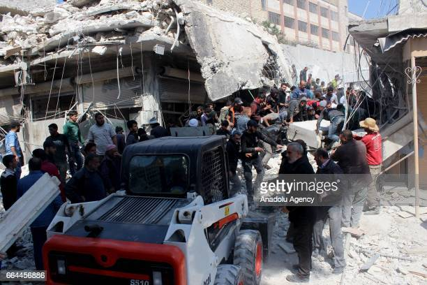 Rescue team workers and civilians search for bodies under the rubble after Russian warcrafts allegedly carried out airstrikes at Ravda Mosque and...