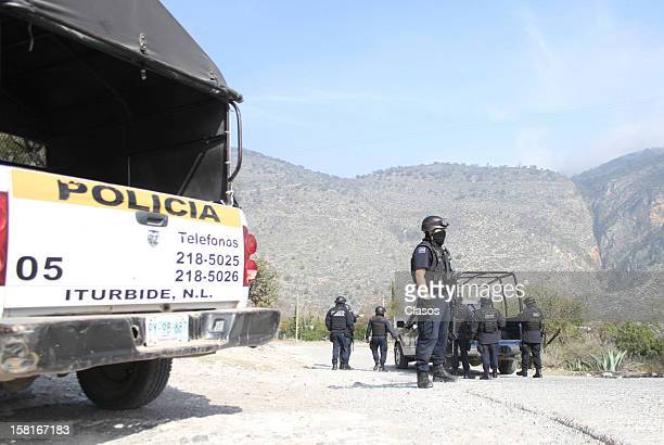 Rescue teams and Federal Police search for the plane where Singer Jenni Rivera was traveling on December 10, 2012 in Nuevo Leon, Mexico.