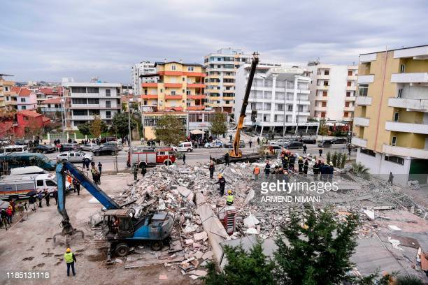 Rescue teams and firefighters search for survivors stuck on a collapsed building in the town of Durres on November 28 after the strongest earthquake...