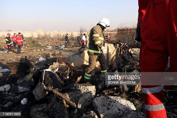 Rescue teams are pictured amid the wreckage after a Ukrainian plane carrying 176 passengers crashed near Imam Khomeini airport in the Iranian capital...