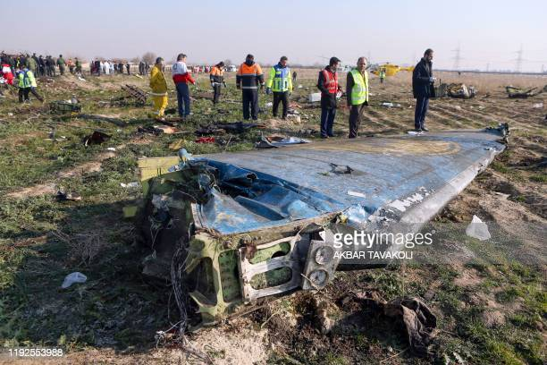 Rescue teams are seen on January 8, 2020 at the scene of a Ukrainian airliner that crashed shortly after take-off near Imam Khomeini airport in the...