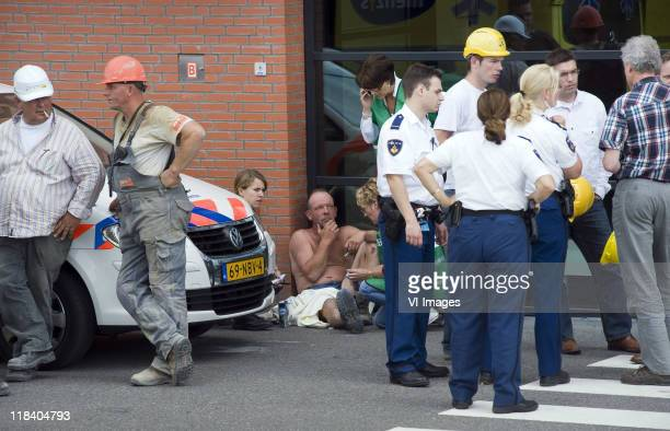 Rescue teams attend the scene after part of the roof of De Grolsch Veste Stadium of Dutch club FC Twente collapsed, on July 7, 2011 in Enschede,...