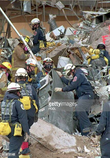 Rescue teams continue the search for bodies in the rubble of the federal building in downtown Oklahoma City 24 April after the 19 April bombing left...