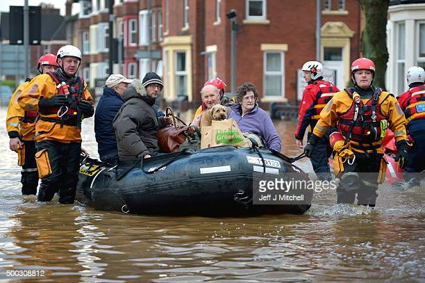 Rescue teams continue to to evacuate people from their homes after Storm Desmond caused flooding on December 7 2015 in Carlisle England Storm Desmond...