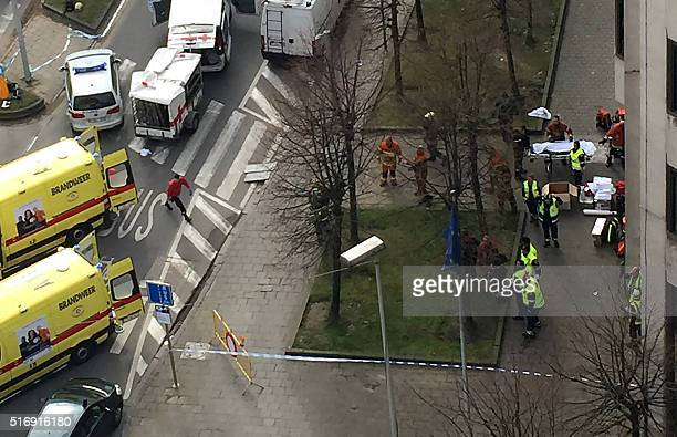 Rescue teams evacuate wounded people outside the Maalbeek Maelbeek metro station in Brussels on March 22 2016 after a blast at this station located...