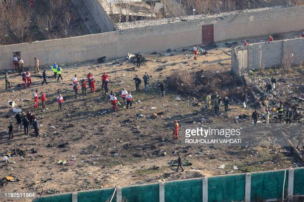 Rescue teams gather at the scene after a Ukrainian plane carrying 176 passengers crashed near Imam Khomeini airport in the Iranian capital Tehran...