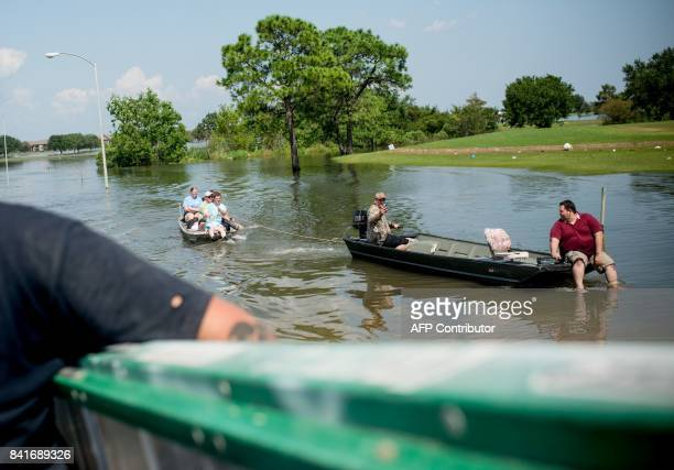 Rescue teams help flood victims in a residential neighborhood in Port Arthur Texas on Thursday September 1 2017 Stormweary residents of Houston and...