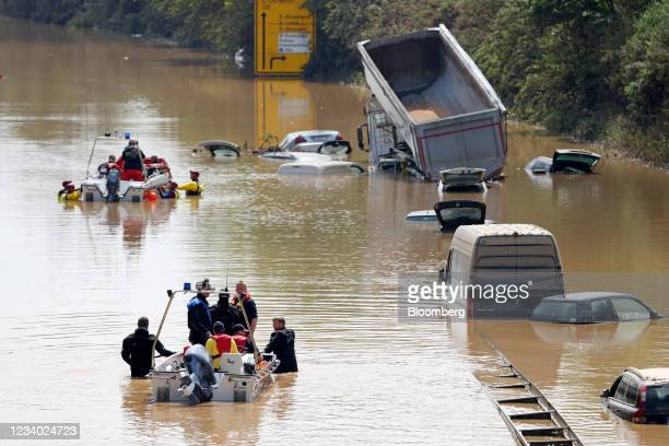 Rescue teams look for victims on a flooded highway in Erftstadt, Germany, on Saturday, July 17, 2021. The death toll from the floods that devastated...