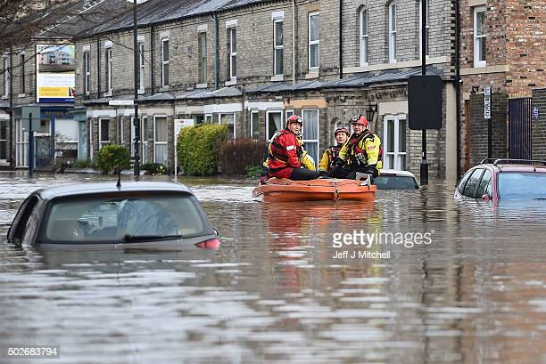 Rescue teams move through flood waters that have inundated homes in the Huntington Road area of York after the River Foss burst its banks on December...