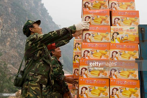 Rescue teams prepare supplies to give to the victims.The county of Beichuan has suffered most of the damage from monday's earthquake and bodies are...
