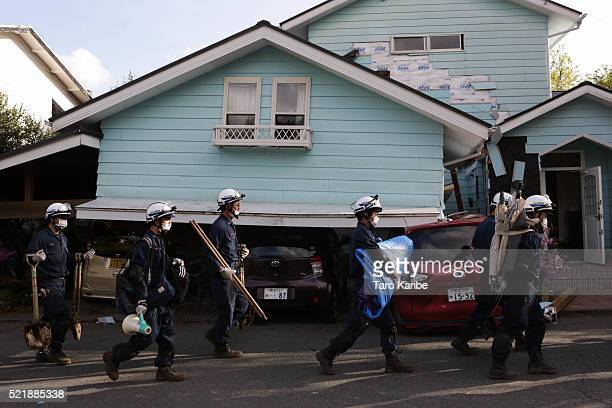 Rescue teams prepare to search for survivors on April 17 2016 in Kumamoto Japan A magnitude73 earthquake hit Kumamoto prefecture on Japan's Kyushu...