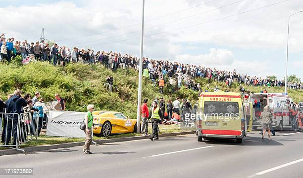 Rescue teams provide assistance to the wounded after the accident which occurred during the auto shows Gran Turismo Polonia 2013 in Poznan on June 30...