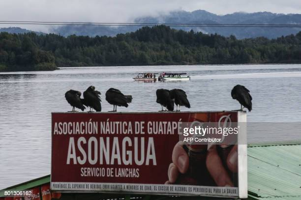 Rescue teams search for survivors after the tourist boat 'Almirante' sank in the Reservoir of Penol in Guatape municipality in Antioquia northwestern...