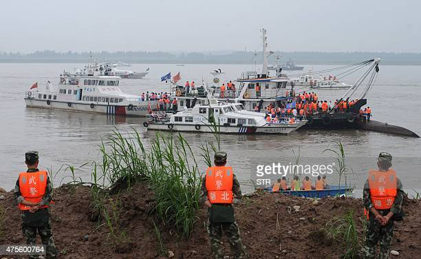 Rescue teams search for survivors near the Dongfangzhixing or 'Eastern Star' vessel which sank in the Yangtze river in Jianli central China's Hubei...