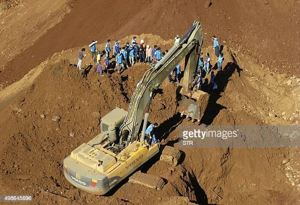 Rescue teams search for the bodies of miners killed in a landslide in a jade mining area in Hpakhant in Myanmar's Kachin state on November 25 2015...