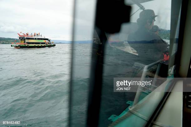 Rescue teams search for victims at the Lake Toba ferry port in the province of North Sumatra on June 19 after a boat capsized on June 18 Several...