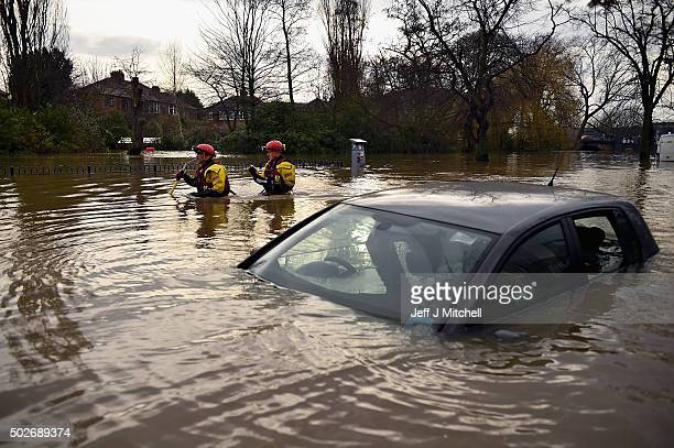 Rescue teams wade through flood waters that have inundated homes in the Huntington Road area of York after the River Foss burst its banks on December...