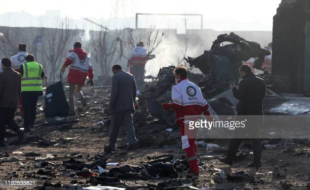 Rescue teams work amidst debris after a Ukrainian plane carrying 176 passengers crashed near Imam Khomeini airport in the Iranian capital Tehran...