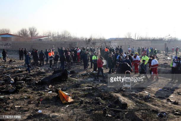 Rescue teams work at the scene after a Ukrainian plane carrying 176 passengers crashed near Imam Khomeini airport in the Iranian capital Tehran early...