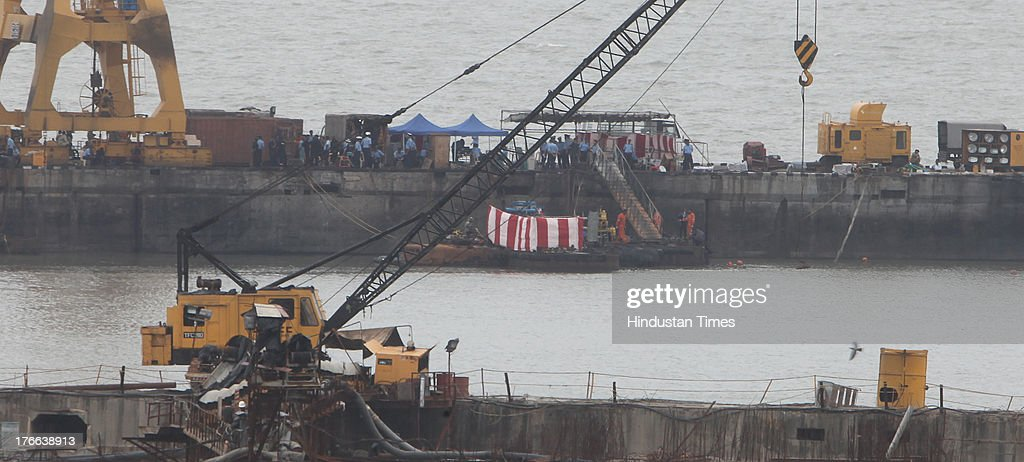 Rescue work at Naval dockyard where explosions occurred in INS Sindhurakshak submarine near Lion Gate on August 16, 2013 in Mumbai, India. A statement issued by the Indian Navy said that the three bodies were extricated from the second compartment behind the conning tower. The fourth personnel was found later.