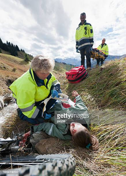 rescue worker attending to mountain bike accident victim