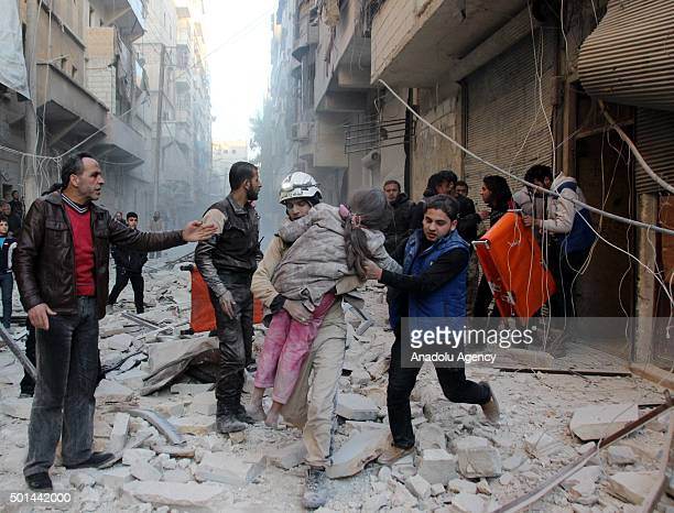 Rescue worker carries the body of dead child after the war crafts belonging to the Russian Army carried out airstrikes on oppositioncontrolled...