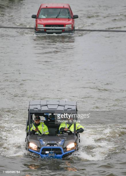 A rescue worker drives though the flooded street of Little York on September 19 2019 in Houston Texas Gov Greg Abbott has declared much of Southeast...