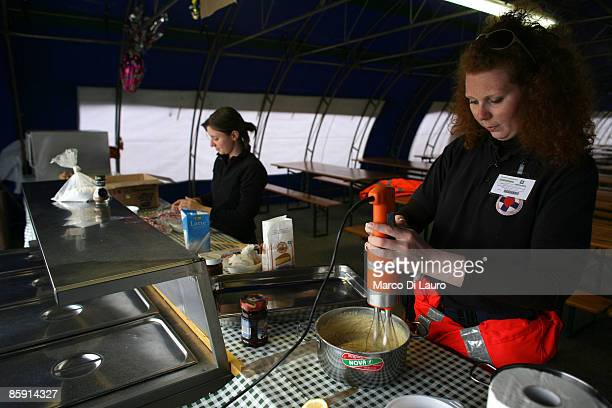 A rescue worker prepares the Easter lunch for the survivors living in the tent camp on April 112009 in Monticchio next to Onna a village near...
