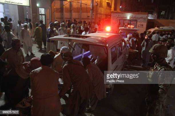 QUETTA BALOCHISTAN PAKISTAN Rescue worker preparing to transport the injured and dead to a hospital A suicide bombing attack on Balochistan Awami...