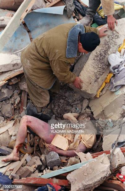Rescue worker removes rubble from the body of a girl in the ruins of Neftegorsk Sakhalin island 29 May 1995 At least 2000 people were feared dead as...