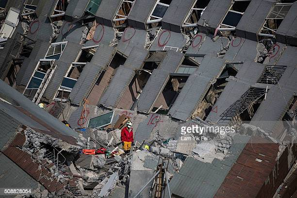 Rescue worker search for victim at a collapsed building on February 7 2016 in Tainan Taiwan A magnitude 64 earthquake hit southern Taiwan early...