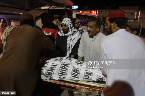 QUETTA BALOCHISTAN PAKISTAN Rescue worker shifting the injured and deceased to a hospital A suicide bombing attack on Balochistan Awami Party corner...