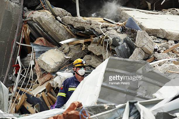 A rescue worker walks into the remains of the CTV building on February 24 2011 in Christchurch New Zealand A massive search and rescue mission is...