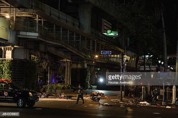 Rescue worker walks past the scene of an explosion on August 17, 2015 in Bangkok, Thailand. A large explosion believed to be from a bomb has happened...