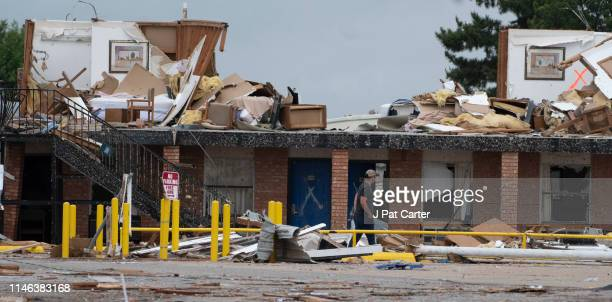 A rescue worker walks through the destruction of the American Value Budget Inn May 26 2019 in El Reno Oklahoma At least two people were killed in...