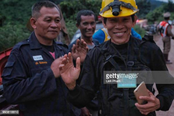 Rescue workers along the main road leading to Tham Luang Nang Non cave as the first 2 ambulances carrying 2 boys pass by on July 8 2018 in Chiang Rai...