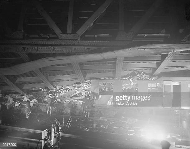 Rescue workers amidst the wreckage of a rail crash outside St John's Station Lewisham on the 4th December 1957 The 456 train from Cannon Street...