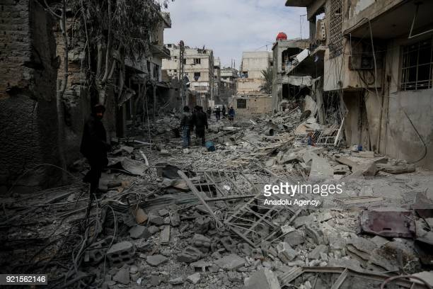 Rescue workers and citizens search and inspect the debris of buildings after Assad Regime carried out an airstrike over Sakba town of Eastern Goutha...
