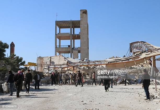 Rescue workers and civilians inspect the debris of a collapsed hospital belongs to humanitarian aid organization 'Doctors Without Borders' to save...