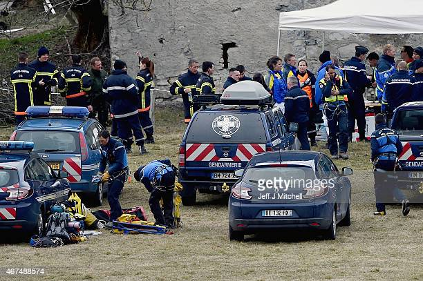 Rescue workers and gendarmerie continue their search operation near the site of the Germanwings plane crash near the French Alps on March 25 2015 in...