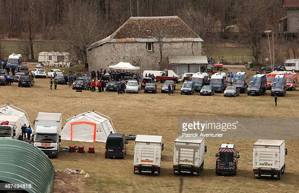 Rescue workers and gendarmerie continue their search operation near the site of the German airliner that crashed in french Alps on March 25 2015 in...