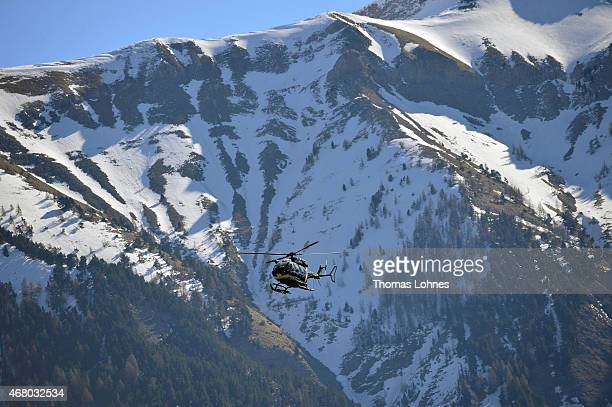 Rescue workers and gendarmerie continue their search operation near the site of the Germanwings plane crash on March 29, 2015 in Seyne les Alpes,...