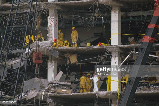 Rescue workers and industrial cranes sift through the rubble of the destroyed Federal Building in the aftermath of the Oklahoma City bombing On April...