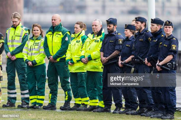 Rescue workers and police from the city of Stockholm attend the city of Stockholm's official ceremony for the victims of the recent terrorist attack...
