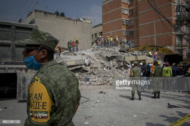 Rescue workers and volunteers listen to directions before a search operation at a collapsed building in Mexico City Mexico on Wednesday Sept 20 2017...