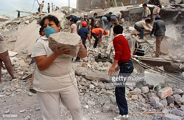 Rescue workers and volunteers sift through the rubble of a collapsed building in 'Zona Rosa' area of Mexico City a popular commercial and tourist...