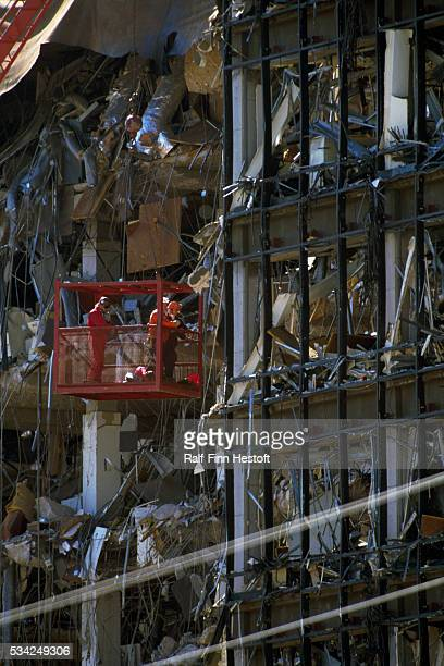 Rescue workers are lifted in a basket to reach the higher floors of the destroyed Federal Building in the aftermath of the Oklahoma City bombing On...