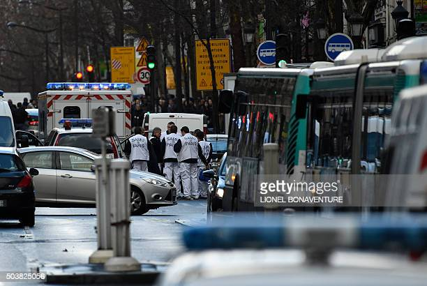 Rescue workers are seen at the Boulevard de Barbes in the north of Paris on January 7 after police shot a man dead as he was trying to enter a police...