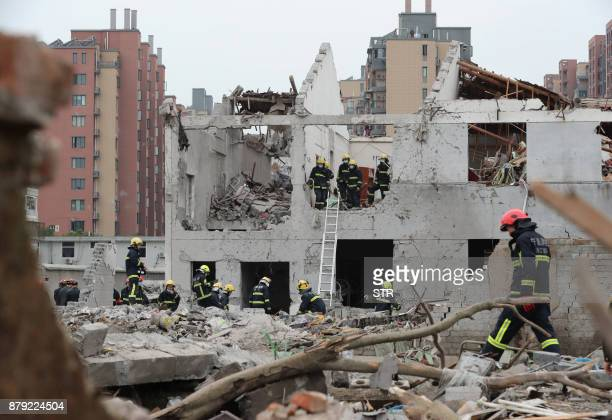 TOPSHOT Rescue workers are seen at the site of an explosion in Ningbo China's eastern Zhejiang province on November 26 2017 A major explosion hit...